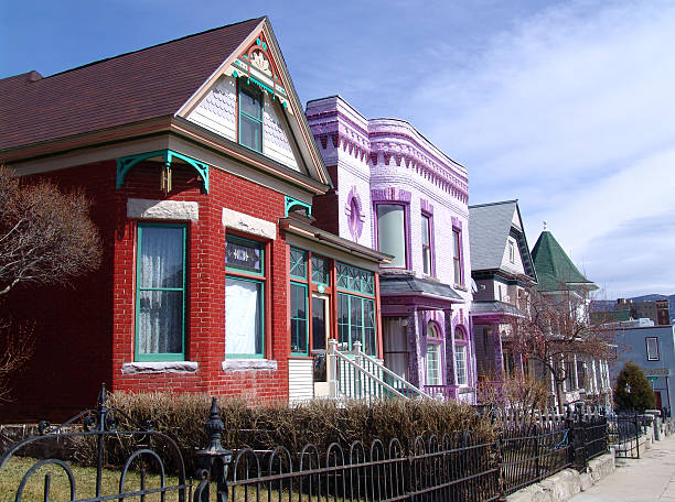 Old victorian homes line in a street stock photo