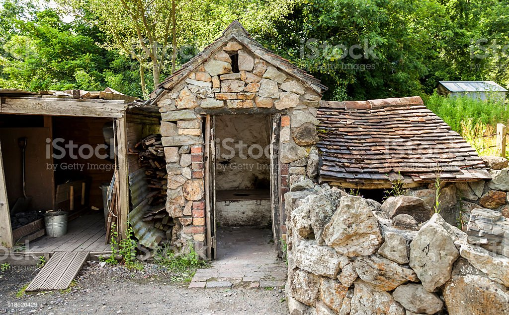 Old Victorian outhouse with coal shed stock photo