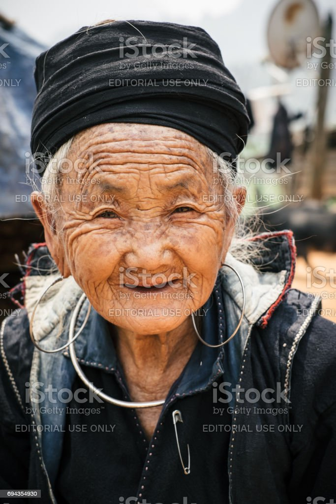 Old vietnamese woman portrait in Sapa stock photo