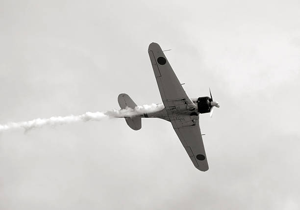 Old vintage airplane flying in the sky stock photo