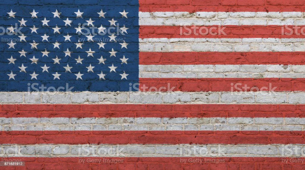 Old vintage American US flag over brick wall stock photo