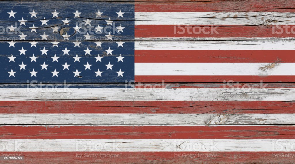 Old vintage American US flag over white wood stock photo