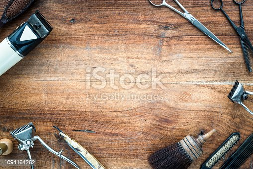 istock Old vintage barbershop tools on wooden table - barbershop background with copy-space 1094164262