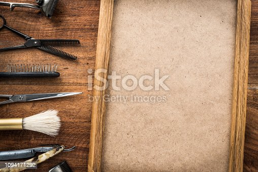 istock Old vintage barbershop tools on wooden table - barbershop background with copy-space 1094171292
