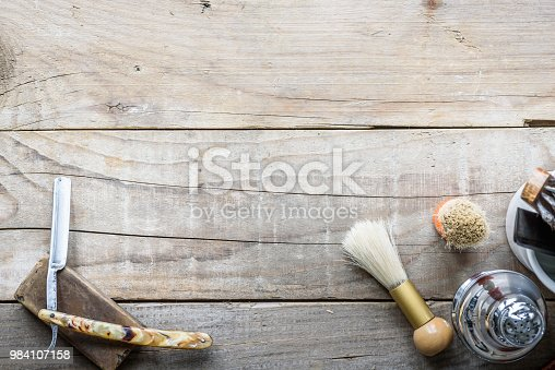 istock Old vintage barbershop tools on wooden table 984107158