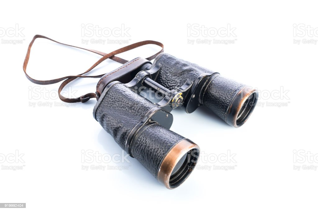 Old vintage binoculars on white background, reflections and shadows, Soviet binoculars WWII stock photo