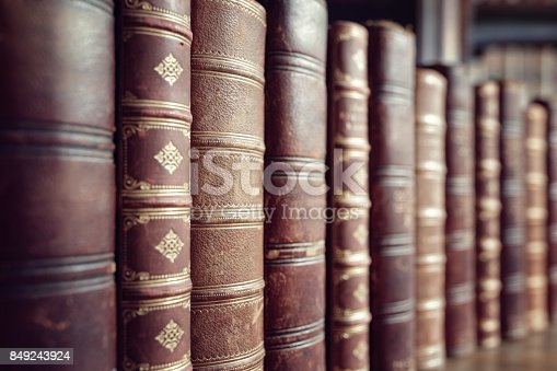 istock Old vintage books in a row 849243924