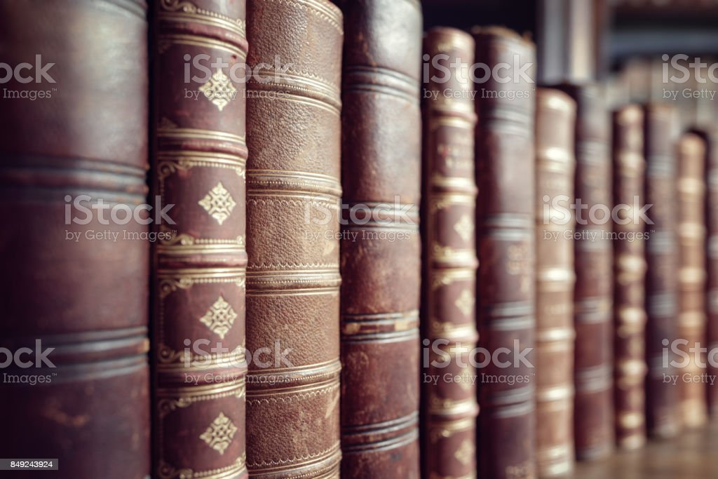 Old vintage books in a row stock photo