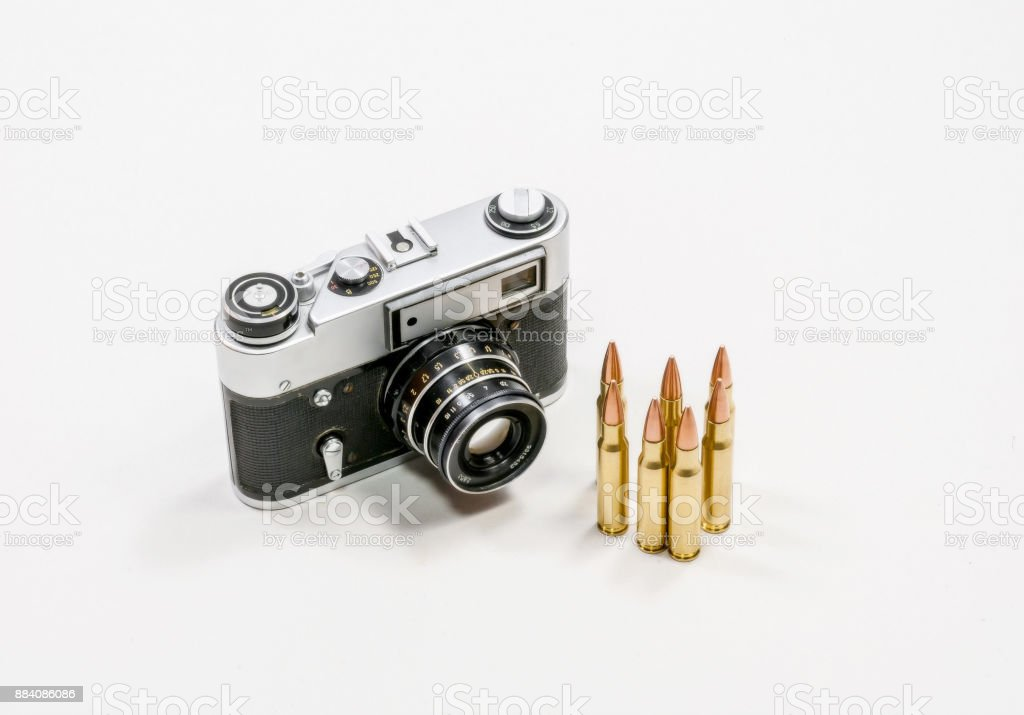 Old vintage camera and automatic cartridges stock photo