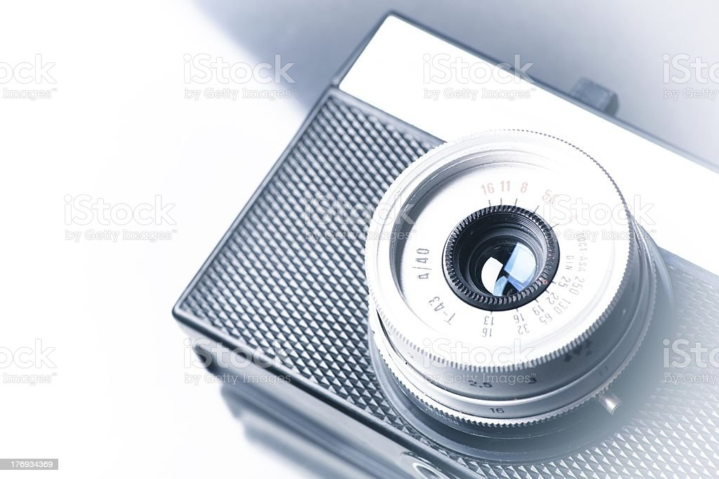 Old vintage camera on background, copyspace royalty-free stock photo