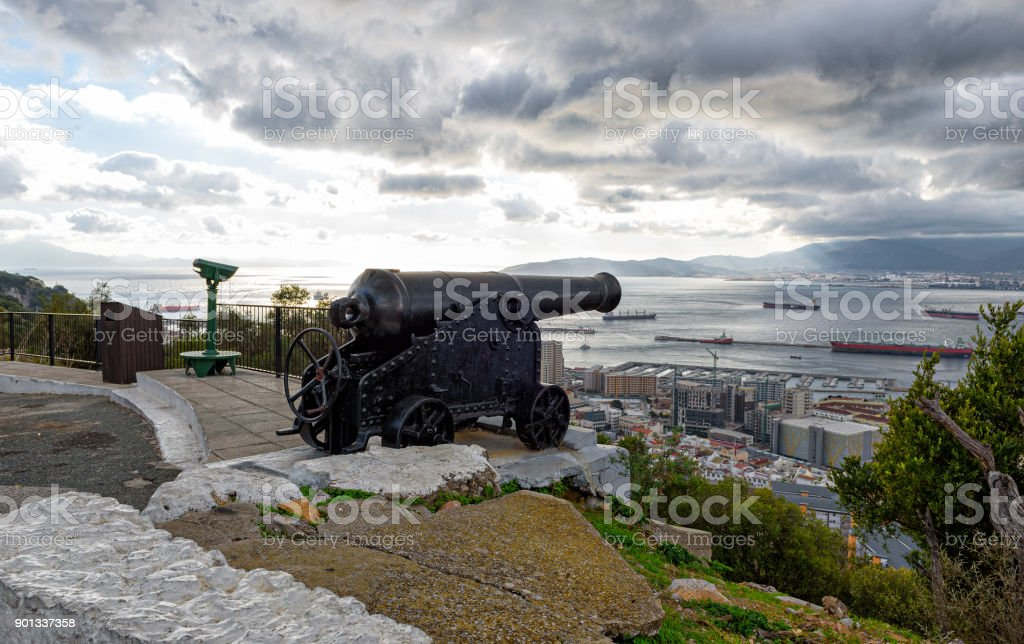 Old vintage cannon protecting sea bay on rock of Gibraltar stock photo