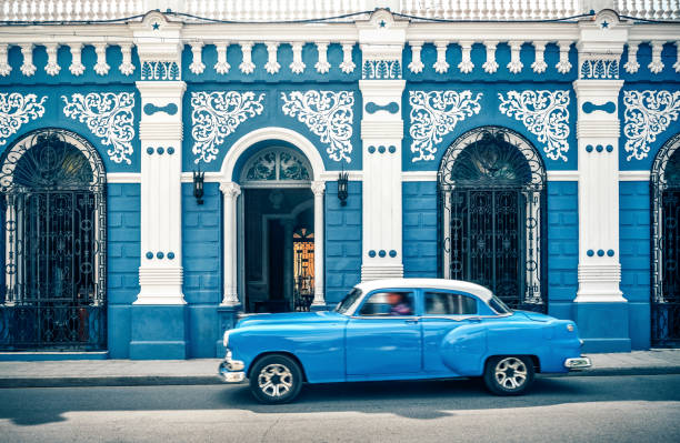 old vintage car in front of colonial style house, cuba - cuba stock photos and pictures