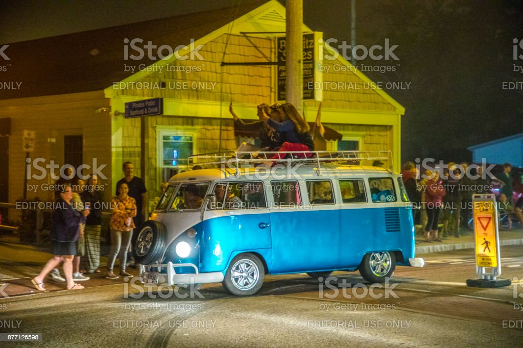 Old vintage cars at the 24th Annual Old Orchard Beach Maine Car Show  drive along by night stock photo