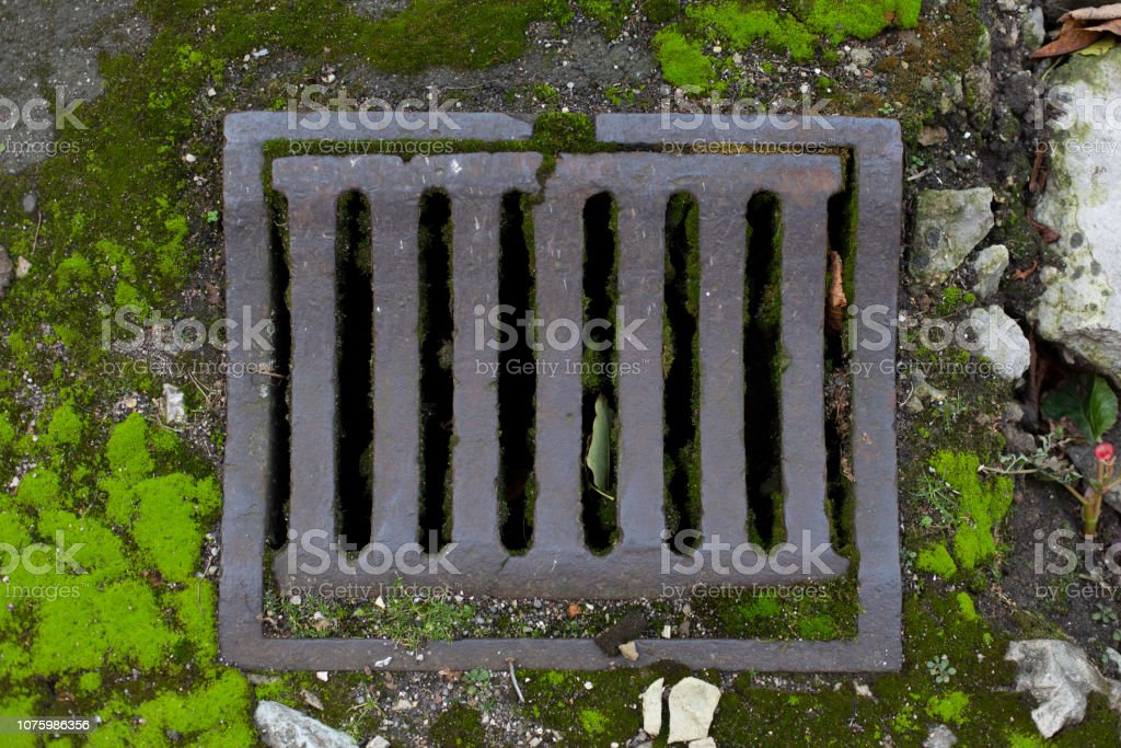 Old vintage city sewer grate road drainage - Royalty-free Aging Process Stock Photo