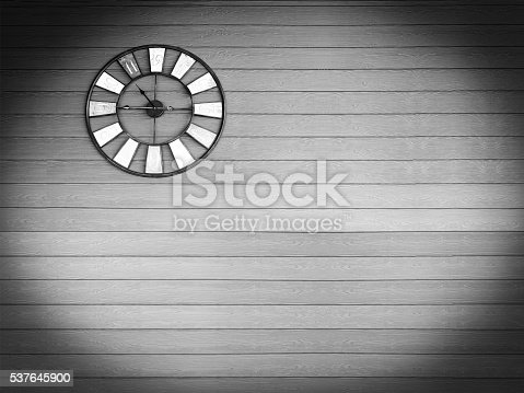671883446 istock photo Old vintage clock on green wooden plank wall background. 537645900