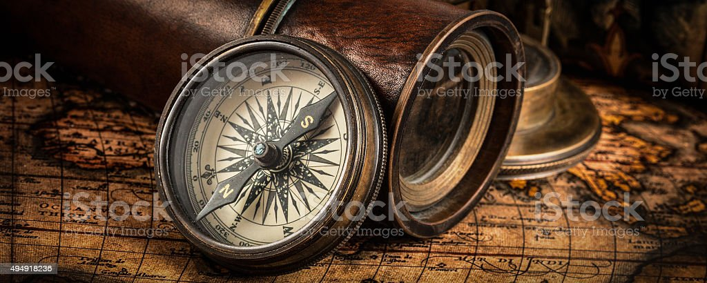Old vintage compass on ancient map stock photo