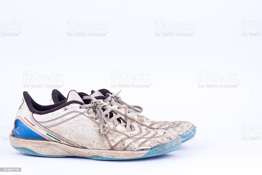Old vintage damaged futsal sports shoes  on white background  isolated stock photo