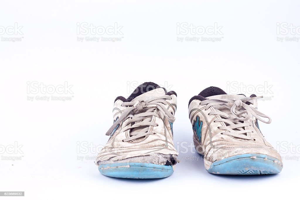 Old vintage damaged futsal sports shoes  on white background  isolated stock photo