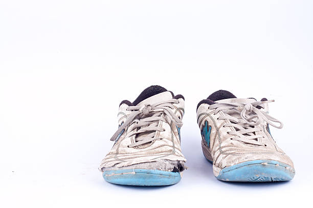 old vintage damaged futsal sports shoes  on white background  isolated - alte schuhe stock-fotos und bilder