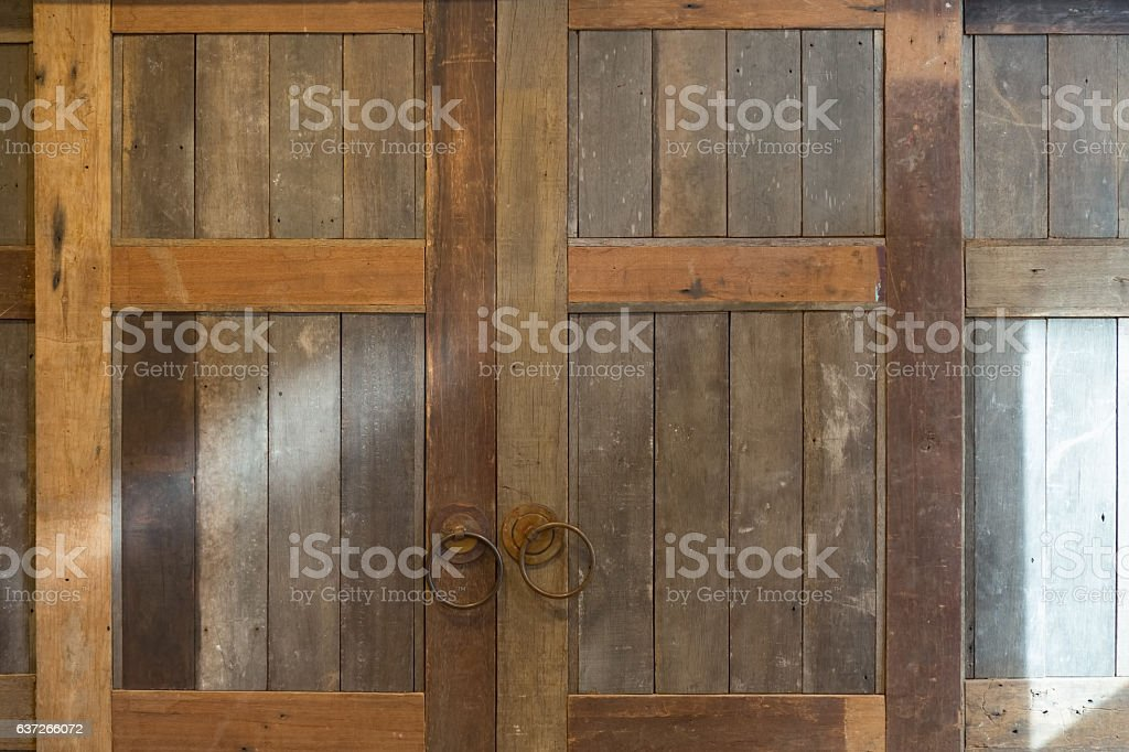 Old vintage folding wooden door stock photo