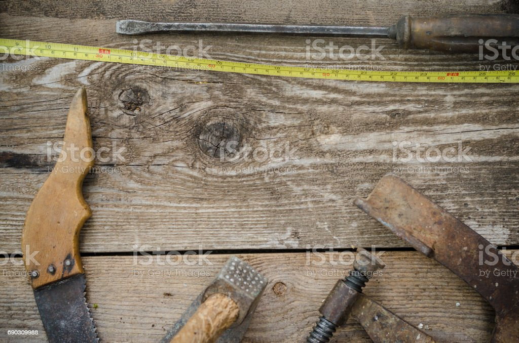 Old vintage hand tools on wooden background. Carpenter workplace stock photo