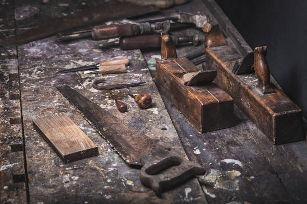 Old vintage hand tools on wooden background stock photo