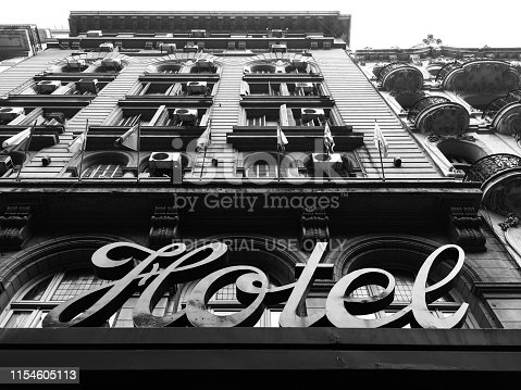 Buenos Aires, Argentina - June 6, 2019: Low angle view of old hotel building and sign located on the famous Avenida de Mayo. At the beginning of the 20th century and with the advent of the 100th anniversary of the country, lots of hotels where built here in order to receive the future visitors of the event