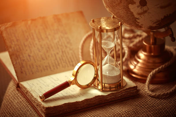 Old vintage items of the treasure hunter, traveler and discoverer - a magnifying glass, old manuscripts, a globe, keys to chests. The concept of luck, unexpected wealth, luck and romance. stock photo