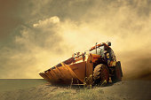istock Old vintage JCB on ground with cloudy sky 1152984589