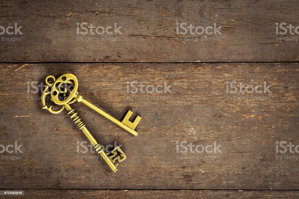old vintage key on wood background with space stock photo