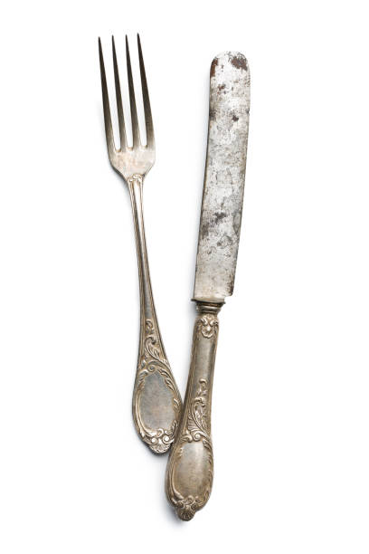 old vintage knife and fork on white background stock photo