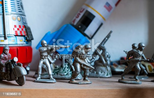Old vintage lead soldiers toys on shelf. Collection of vintage toys in a shop. Bright colours.