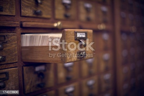 An antique card catalog drawer, open and ready. Horizontal with copy space.