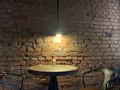 istock old vintage loft brick wall lamp and table 1222003100