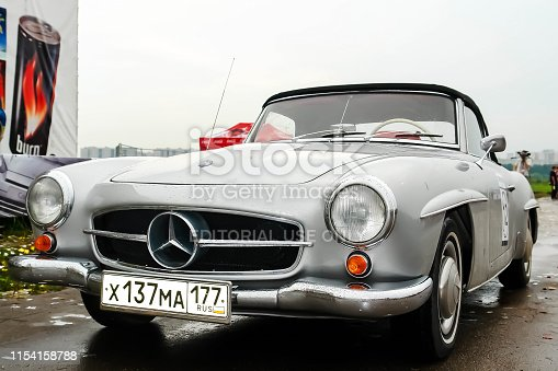 Moscow, Russia - May 25, 2019: old vintage mercedes benz 190 SL convertible in gray color parked. Front close up