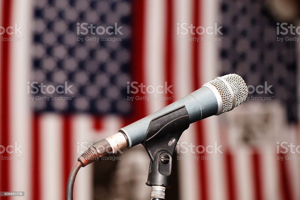 Old vintage microphone on the background of the American flag stock photo
