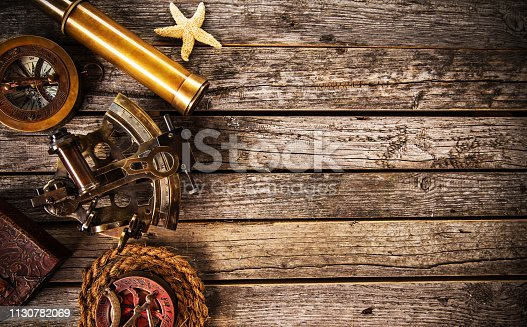 istock Old vintage navigation equipment on wooden table. 1130782069