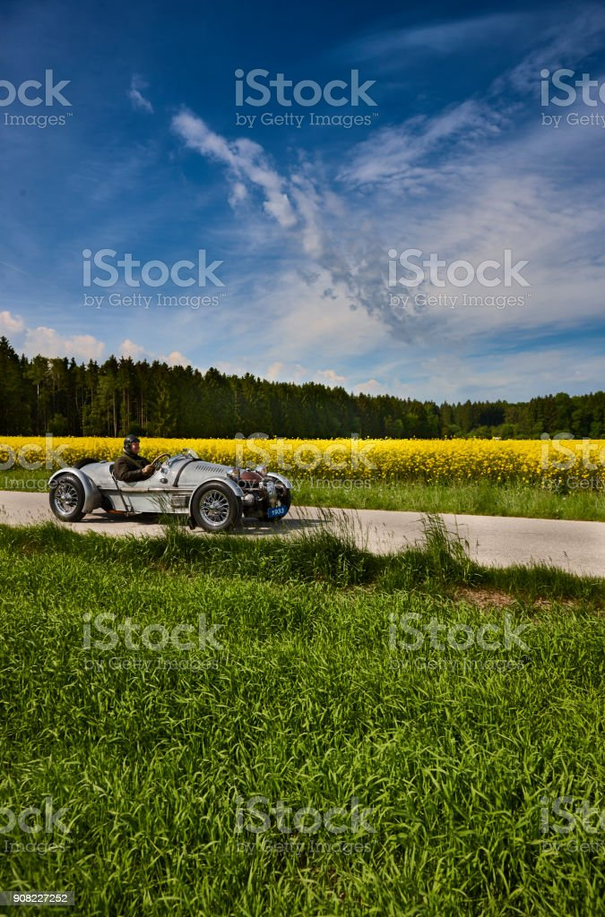Old vintage open top car on the country road stock photo