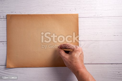 891131294 istock photo Old vintage paper sheet texture on wood background 1254723603