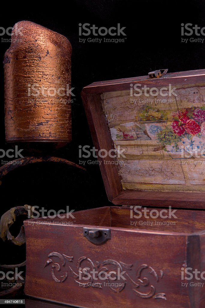 old vintage patterns chest with bronze candle stock photo