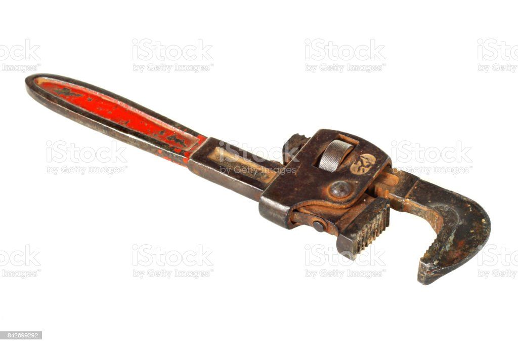 Old Vintage red handled plumbers pipe wrench  Isolated on White Background stock photo