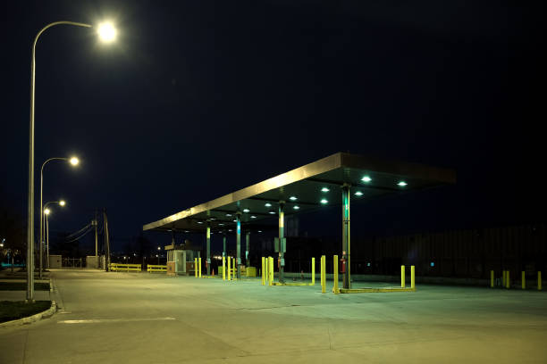 Old vintage retro industrial gas station at night stock photo