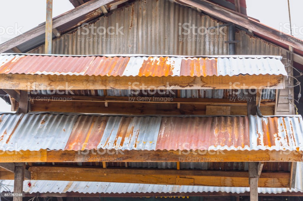 old vintage rust roof wood building rusty metal zinc sheet texture stock photo