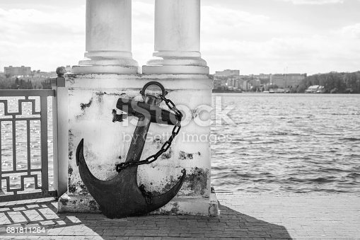 istock Old vintage rusty anchor in the park near lake 681811264