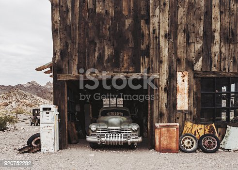 Old vintage rusty car truck abandoned in the abandoned gas station.