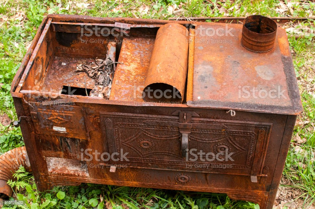 Old vintage rusty stove stock photo