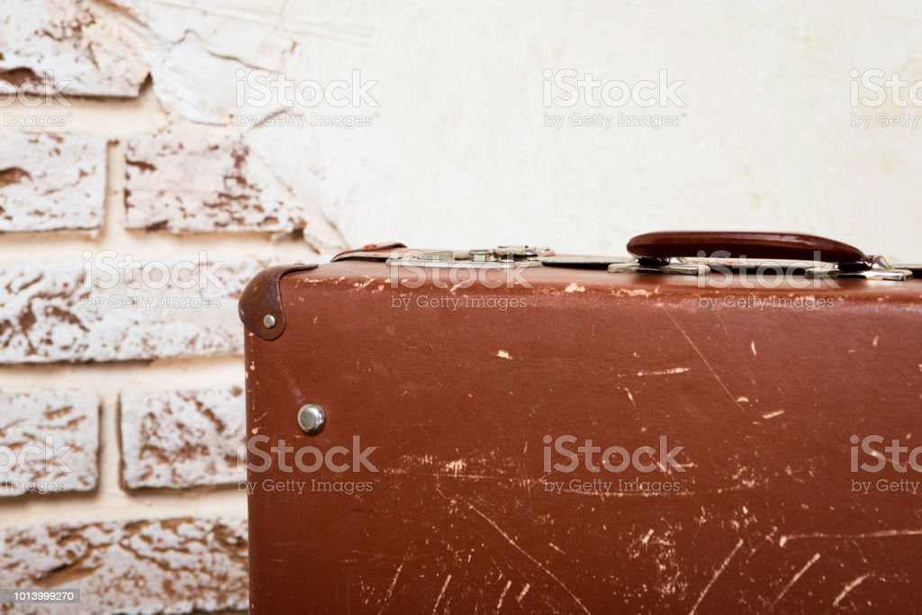 old vintage suitcase in the concrete light room стоковое фото
