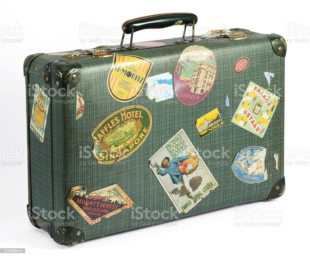 Old vintage suitcase with travel labels stock photo