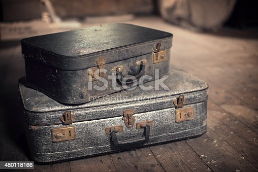 istock Old vintage suitcases in a dusty attic 480118166