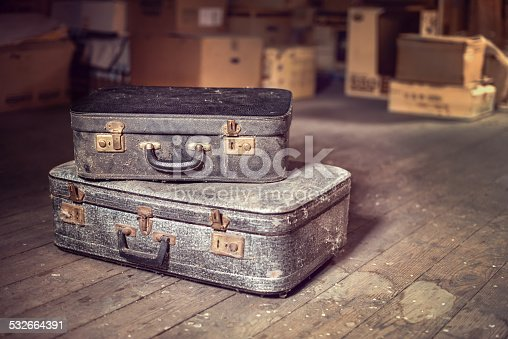 istock Old vintage suitcases in a dusty attic 532664391